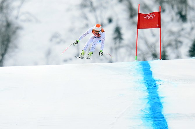 American skier Bode Miller flies over a jump at the bottom of the downhill course Sunday at the Rosa Khutor Alpine Center in Krasnaya Polyana, Russia, during the men's downhill at the 2014 Winter Olympics.