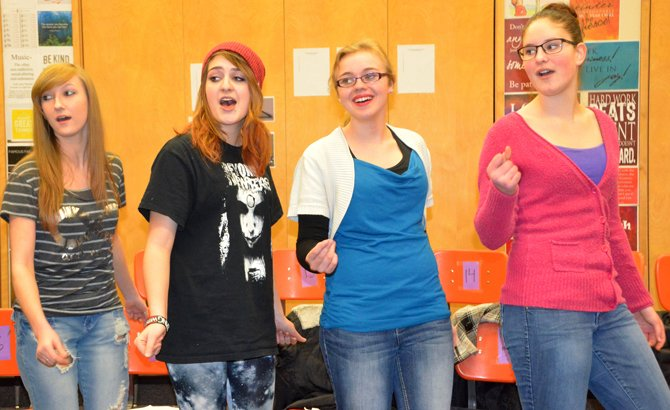 "Moffat County High School singers dance and snap their fingers to the romantic song ""L-O-V-E."" The song is one of several selections the CenterStage choir will be performing as singing valentines for community members this week."