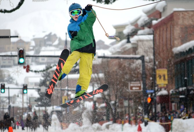 Liam Baxter, 11, caught some of the biggest air during Sunday's donkey jump at the 101st Winter Carnival. Baxter couldn't stick the landing but pumped his fist to the cheering crowd after his fall.