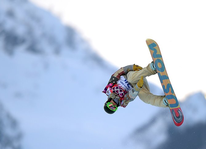 Taylor Gold flies high above the Rosa Khutor Extreme Park in Russia on Tuesday during the qualifying round of the men's half-pipe competition at the Winter Olympics. Gold made it into the semifinals with a pair of strong runs but couldn't advance to the finals.