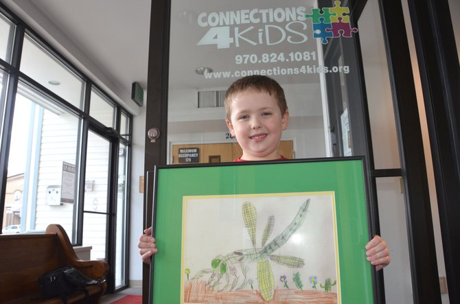 The artwork of Sandrock Elementary first-grader Kyler Arnold, pictured, will be featured on the cover of the upcoming calendar for nonprofit organization Connections 4 Kids. During its third annual Cherish the Little Things art show last week, the group raised more than $10,000.