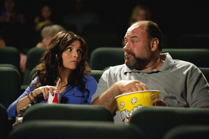 "Couple Eva and Albert (Julia Louis-Dreyfus, James Gandolfini) have an uncomfortable moment in ""Enough Said."" The movie is about a woman who unintentionally learns her new boyfriend's worst traits from his ex-wife."