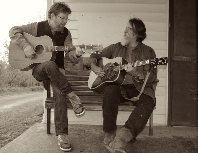 "Tim O'Brien and Darrell Scott have joined together again for a tour and a new album, ""Memories and Moments.""