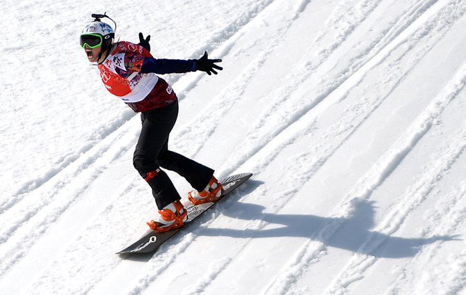 Eva Samkova screams as she flies toward the finish line of the women's snowboard cross finals in first place on Sunday at Rosa Khutor Extreme Park in Krasnaya Polyana, Russia. The Czech snowboarder won the gold medal.