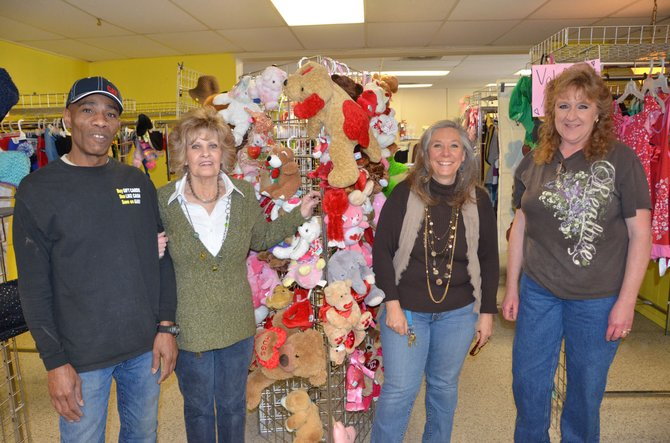 From left, Community Budget Center workers Ron Logan, Shirley Zulian, Karen Brown and Tina Williams gather around a selection of stuffed animals for sale. Besides providing inexpensive secondhand materials for sale, the Budget Center assists the people of Craig and Moffat County who are struggling financially, through various methods.