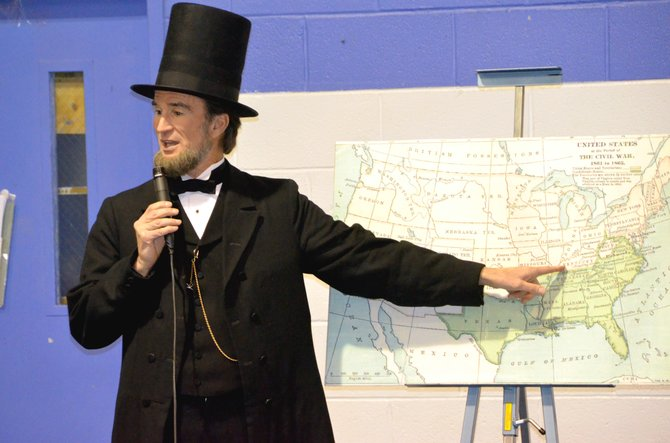 Abraham Lincoln re-enactor John Voehl points to Lincoln's birth state of Kentucky on a Civil War era map while speaking at the Boys & Girls Club of Craig on Tuesday afternoon. Voehl made several appearances in Craig as the historical figure Monday and Tuesday, discussing the former president's life and impact on the United States.