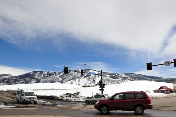 Traffic moves through the intersection of Pine Grove Road and Central Park Drive on Tuesday afternoon. The city of Steamboat Springs and Yampa Valley Medical Center have started talking about the possibility of the city building a police station on the lot.