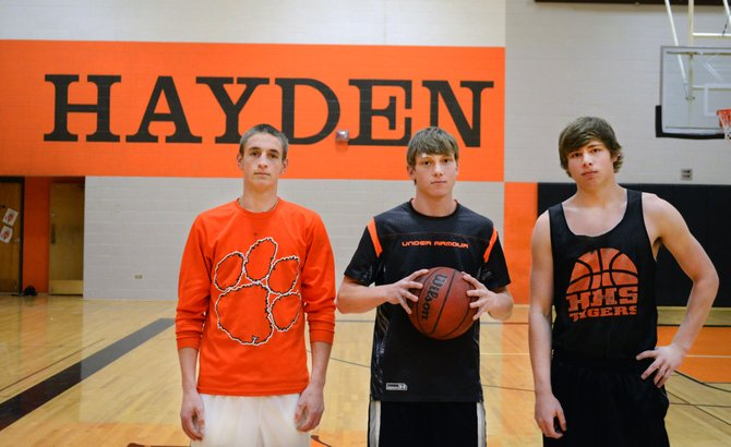 Hayden seniors, from left, Isaac Bridges, Dan Engle and Greg Frentress eye one last run together on the hardwood as the Tigers' season nears its end.