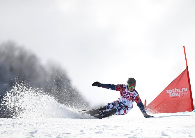 Vic Wild flies around a gate Wednesday on what turned out to be his gold-medal run in the men's parallel giant slalom at the Rosa Khutor Extreme Park in Krasnaya Polyana, Russia, site of the 2014 Winter Olympics mountain events. Wild was born in the United States and trained in Steamboat Springs but received Russian citizenship in 2012 after American funding for his sport dried up.
