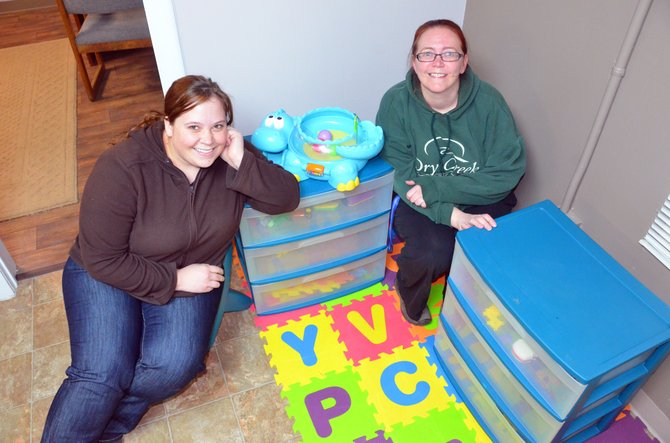 Katie Grobe, executive director of the Yampa Valley Pregnancy Center, right, and volunteer Bethany Longwell spell out the organization's initials with the interlocking, multicolored, soft floor tiles within the children's play section of their office at 25 W. Victory Way. YVPC will host an open house for those interested in learning more about the organization at 6 p.m. Thursday.