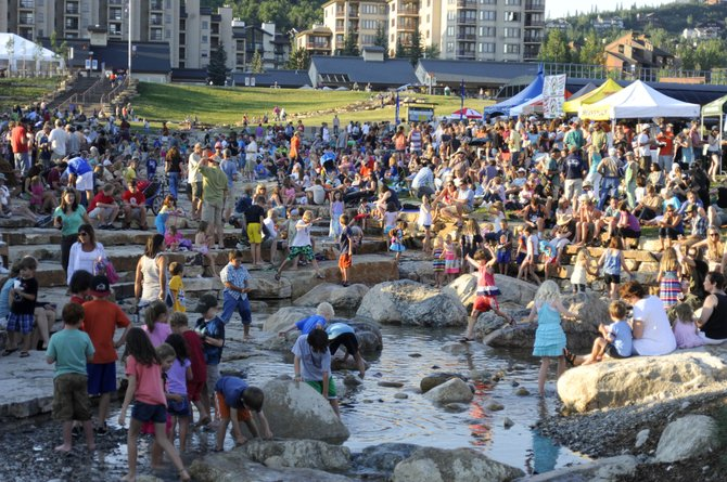 People gather at the promenade at the base of Steamboat Ski Area for the Free Summer Concert Series show featuring Carolina Chocolate Drops. The promenade has been featured in the latest issue of Landscape Architect magazine.