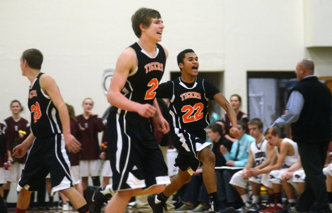 Hayden boys basketball players fly to the bench following their 39-37 upset win against Soroco on Friday night.