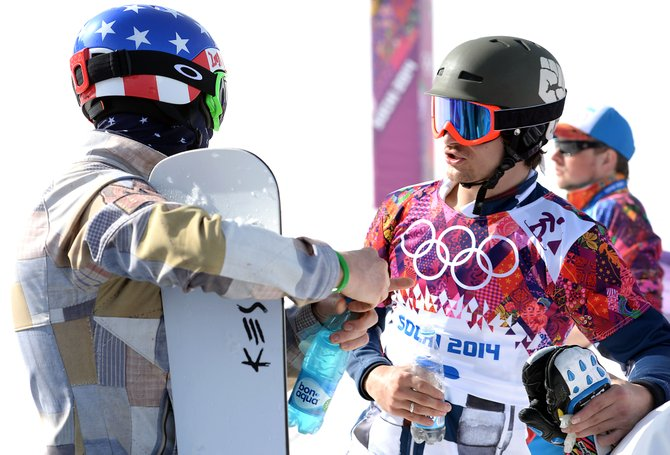 Justin Reiter, left, and Vic Wild discuss course strategy between runs as Wild pushed for a second gold medal Saturday at the men's parallel slalom event at the 2014 Winter Olympics. Reiter, a Steamboat Springs-based snowboarder, was left to coaching after a disappointing day trying to qualify for the event's bracketed finals.