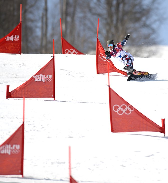 Vic Wild navigates his way through the parallel slalom course at the 2014 Winter Olympics on Saturday. Wild won the event, the second gold medal in three days for the American who gained Russian citizenship to pursue his sport.