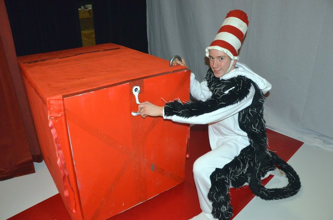 "The Dr. Seuss character the Cat in the Hat (Moffat County High School freshman Micajah Prescott) prepares to unleash a box full of trouble. The MCHS theater program will perform ""The Cat in the Hat"" starting Thursday night in the school auditorium."