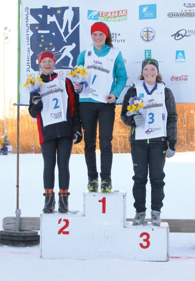 Gabby Armstrong, center, of the Eastern Division, won the girls Nordic combined event at this week's 2014 Junior National Championships. She shares the podium with Central's Cara Larson, left, who finished second, and Steamboat Springs' Logan Sankey, who finished third.