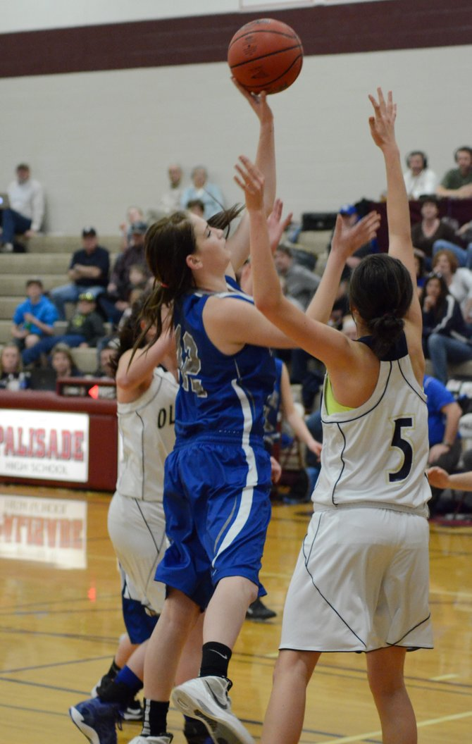 Allie Ehlers puts up a left-handed shot as she darts through the lane Saturday in Palisade. Moffat County won its second consecutive district title against Olathe on Saturday, holding off a late Pirates rally to win, 47-44.