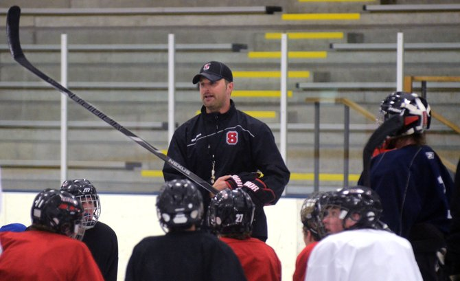 Steamboat Springs High School hockey coach Brent Tollar, center, said that if the Colorado High School Activities Association was to approve a switch to a two-classification system, he'd like his team to play with the bigger schools.