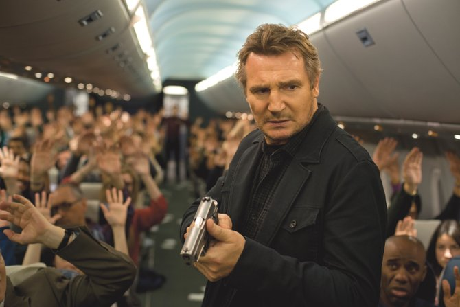 "Bill Marks (Liam Neeson) searches for a possible killer in ""Non-Stop."" The movie is about an air marshal who must discover who is sending him deadly threats in the middle of a transatlantic flight."