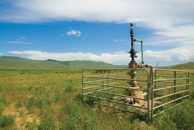A natural gas well sits to the side of an empty wheat field off state Colo. 13, north of Craig. Southwestern Energy, the fifth largest natural gas company in the United States, announced Wednesday that it entered an agreement to purchase 312,000 acres of land in Moffat and Routt counties for natural gas exploration.