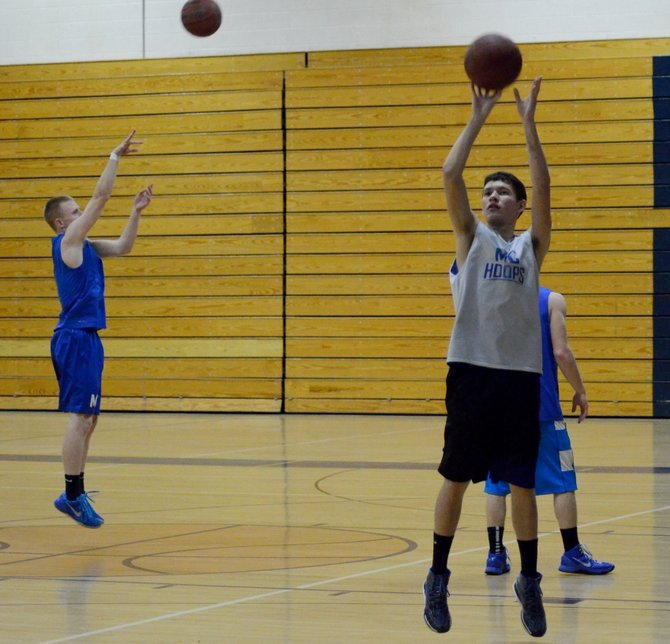 Kody Fief (right) and Tyler Davis put up jumpers during practice Wednesday at Moffat County High School. The boys basketball team is prepping for its regional semifinal game against Sheridan this Friday.