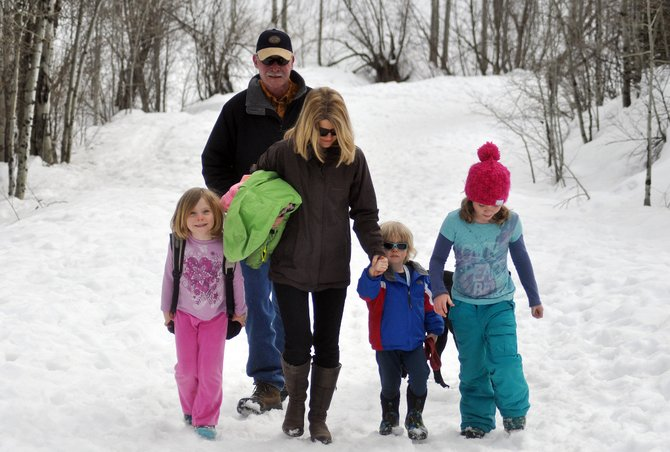 The Mitchell family takes a walk on a snowy Spring Creek Trail on Thursday afternoon. The trails lodging tax steering committee has started prioritizing trail projects, including an enhanced pedestrian access to the Spring Creek Trail.