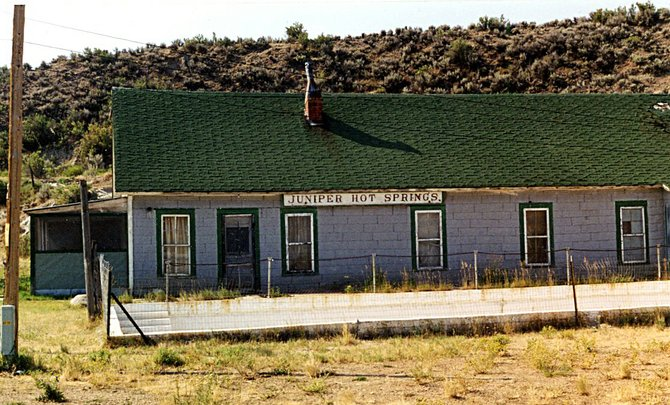 Still standing in 1999, the old Juniper Hot Springs complex gradually fell into disuse and disrepair. The buildings were torn down shortly after this photo was taken. Photographer Bill Hill.