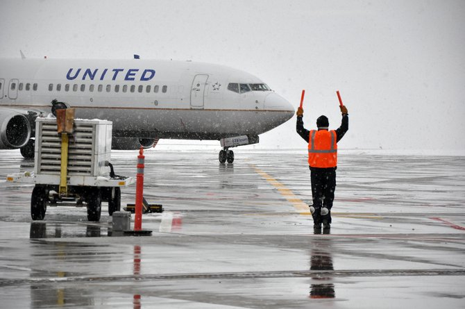 A United plane full of arriving tourists is guided into Yampa Valley Regional Airport during the holiday season. The airport reported this week that the number of arriving passengers in February dipped by almost 800, about 4 percent, from traffic reported in February 2013.