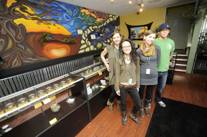 Golden Leaf recently opened its doors for recreational marijuana. Pictured are, from right, co-owner Golden Leaf Anderson, and employees Anita Hartley, Ji Hwang and Carly Grier.