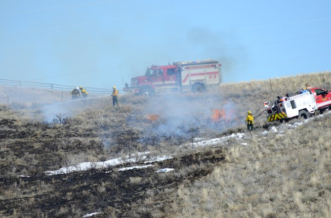 Firefighters put out the last flames from a wildland fire that broke out west of Craig Friday afternoon. The blaze spread about an acre but never threatened any structures and was contained within a half hour.
