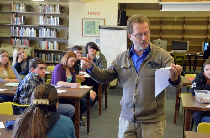 Colorado Poet Laureate David Mason reads from Moffat County High School freshman Marlayna Sparger's untitled poem Friday afternoon in the MCHS library. Mason spoke at MCHS, Craig Middle School and Colorado Northwestern Community College about process of writing poetry and its importance in society.