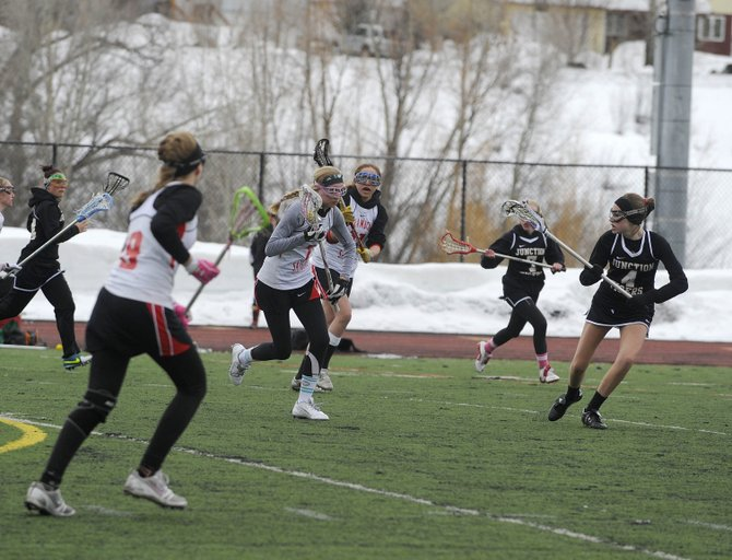 Steamboat Springs High School freshman Libby Lukens brings the ball up the field during Saturday's game against Grand Junction.