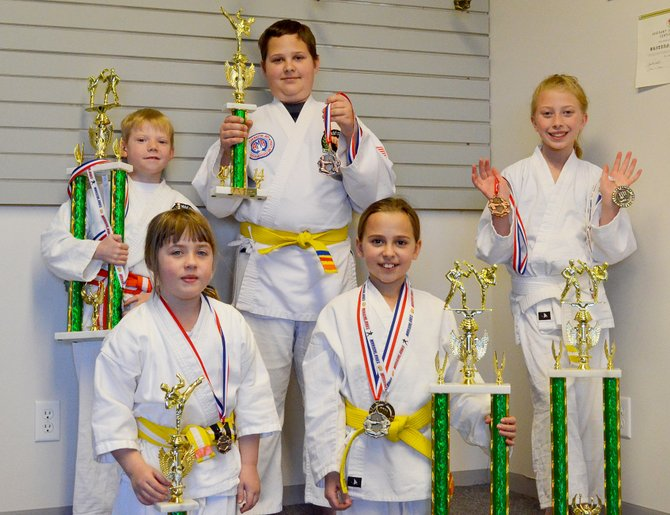 Youth competitors from the Colorado Taekwondo Institute Craig campus competed at the 40th annual CTI Superbowl March 7 and 8. Arianna Anderson (front left), Sumay Potgieter (front right), Evan Montoya (back left), JJ Potgieter (back middle) and Mackenzie Schneider all brought trophies back from the annual event featuring several taekwondo competitions.
