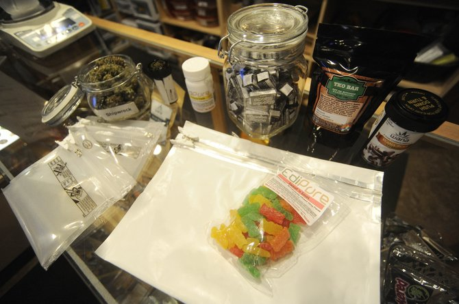 Gov. John Hickenlooper on Monday signed a law that now will require medicinal marijuana edible products to be sold in childproof bags that conceal the bag's contents.