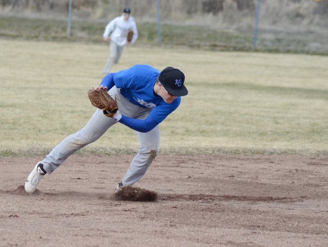 Brett Loyd scoops a ground ball during Moffat County baseball practice Thursday. The Bulldogs are trying to build on a quick start with two wins at Grand Valley Saturday.