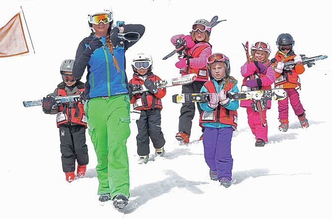 A ski instructor from the Kids Vacation Center leads her students back to the base area Thursday afternoon. Intrawest, the parent company of Steamboat Ski and Resort Corp., no longer will offer seasonal employees health insurance.