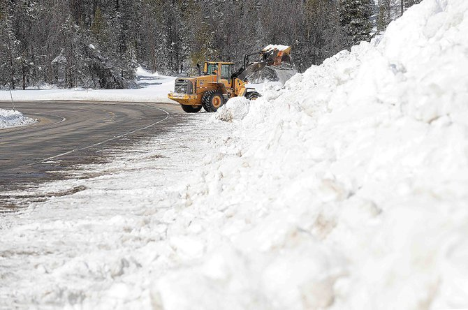 Colorado Department of Transportation employee Doug Brown uses a front-end loader to push snow off the shoulder at the top of Rabbit Ears Pass on Thursday. The department has dealt with a large amount of snow on the highway this winter.