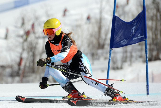 Perri Meeks flies down the course Friday during a giant slalom race at Steamboat Ski Area. Meeks, a junior at The Lowell Whiteman School, is hoping to carry her ski racing into college. She was fourth during Friday's race.