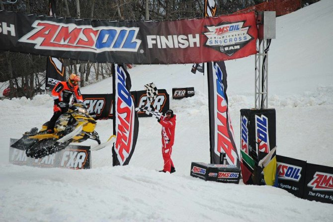 AJ Stoffle crosses the finish line at an AMSOIL Snocross event in Lake Geneva, Wisc. The 16-year-old from Craig impressed at national Snocross events this season, finishing in the top four everywhere he went.