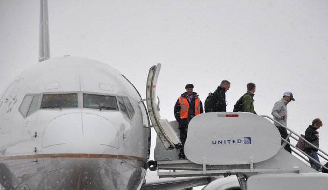 Passengers unload from a United Airlines plane at Yampa Valley Regional Airport during the holiday season. The program that attracts flights to Yampa Valley Regional Airport is projected to be about $1 million under its cap of $4.78 million for revenue guarantees.