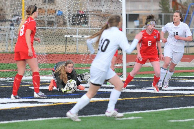 Steamboat's Ocoee Wilson looks upfield after making a save against Eagle Valley during the first period of their matchup Friday in Gypsum. Steamboat went on to win, 3-2.