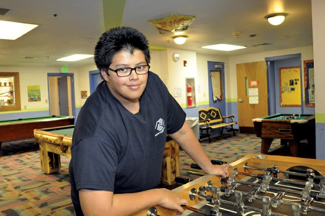 Miguel Meza, shown in 2012, takes a break while working at the Boys & Girls Club of Craig. Meza recently competed for Colorado Youth of the Year with teenagers from across the state, representing the entirety of the Boys & Girls Clubs of Northwest Colorado.