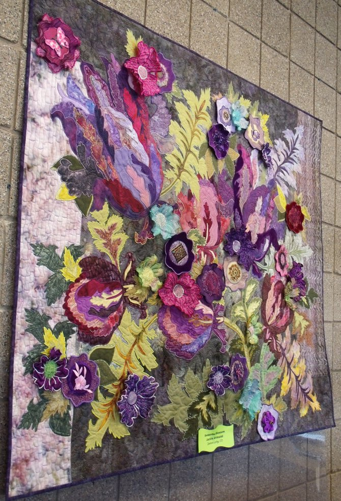 "The quilt ""Awesome Blossom,"" by Jackie Grimaldi, of Steamboat Springs, was voted the favorite among travelers who viewed an exhibition of 34 locally crafted quilts in the secure waiting areas of Yampa Valley Regional Airport this winter."