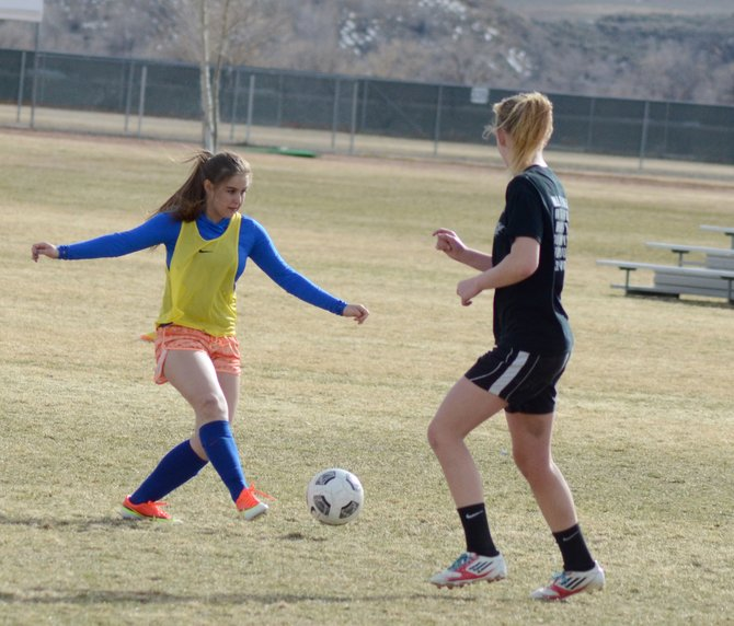 Alex Hamilton makes a pass during Moffat County soccer practice last week. The Bulldogs picked up their first win of the season by beating Vail Mountain, 2-1, on Tuesday in Vail.