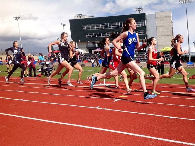 Matti Jo Duzik, of Moffat County, makes a pass around the outside at the Mickey Dunn Invitational on Saturday in Grand Junction. Duzik, a freshman on the track team, took eighth place in the 800-meter run and 10th in the 1600 at the meet.