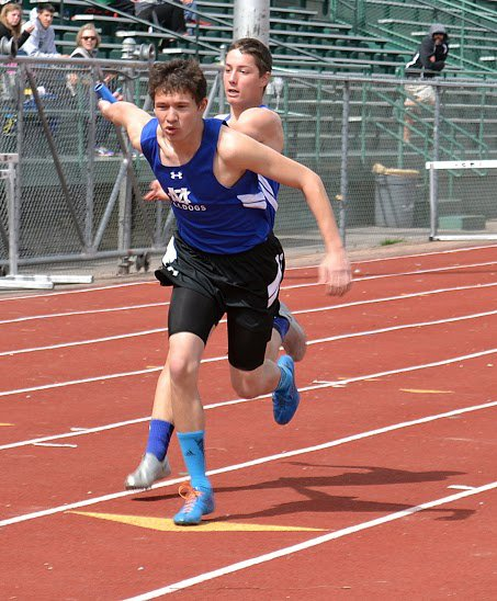Eddie Smercina hands off to Kody Fief in the boys 4x100 meter relay Wednesday at Stocker Stadium in Grand Junction. The boys relay took second place at Grand Junction Central's Warrior Wild West Invitational, one of many high finishes for Moffat County.