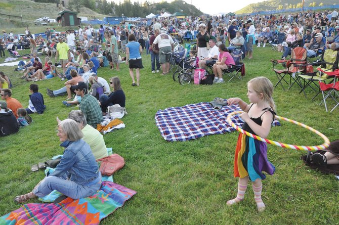 Arion Schweikert twirls a hula hoop in 2010 as she watched the Free Summer Concert Series event at Howelsen Hill.