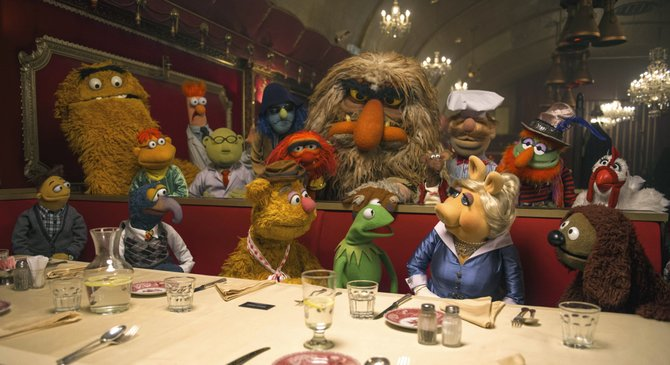 "The Muppets confer about the idea of going on a world tour in ""Muppets Most Wanted."" The movie features the puppet characters unaware that their leader, Kermit the Frog, has been replaced by a dangerous criminal who looks exactly like him."