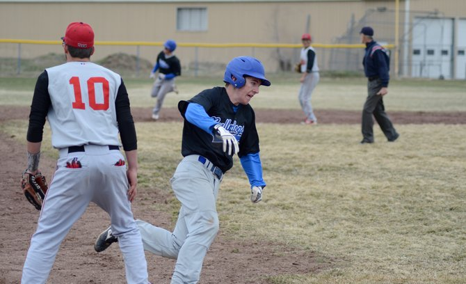 Hugh Turner rounds third base on his way home during Moffat County's second game against Gunnison on Saturday in Craig. The Bulldogs went 0-2 and couldn't shut down the Cowboys' offense.