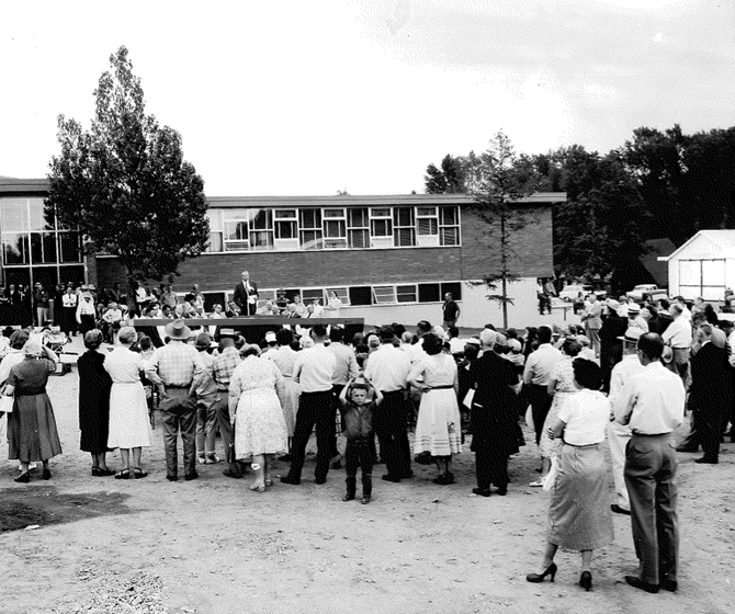 Community members attend the opening and dedication of the new YVEA headquarters in downtown Steamboat Springs in 1956. The electric co-op has put the building under contract with a developer who wants to repurpose it into a building with commercial, residential and retail spaces.